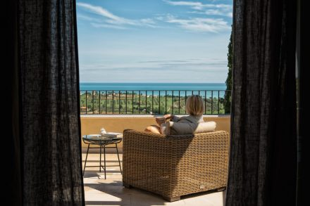 Italy Retreat location - view from inside of a room looking at the balcony and sea
